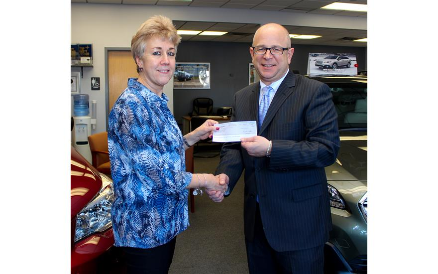 PREMIER SUBARU WATERTOWN PRESENTS A CHECK FOR $15,
