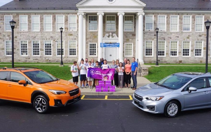 Lacy Subaru Donates Books to CMS