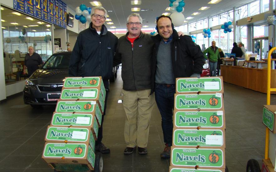Rotarians Deliver Holiday Cheer at Evanston Subaru