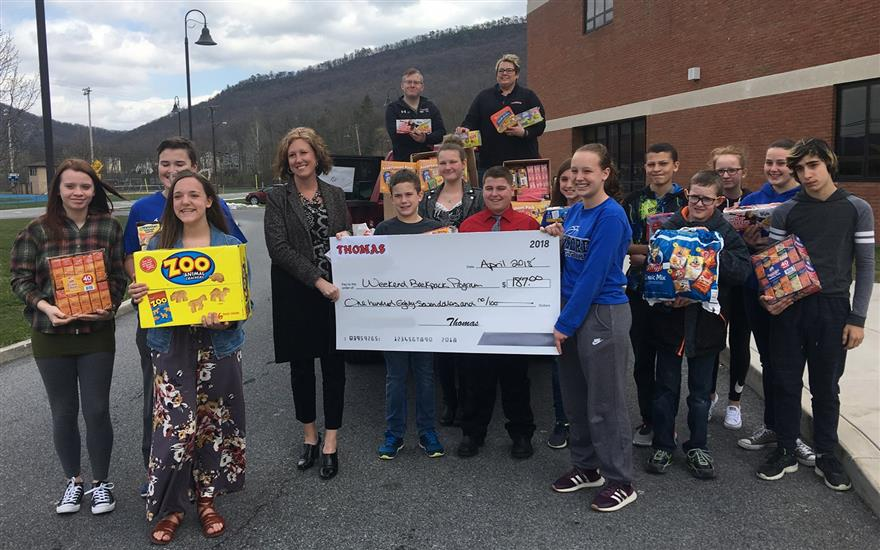 Thomas Donates to Weekend Backpack Program