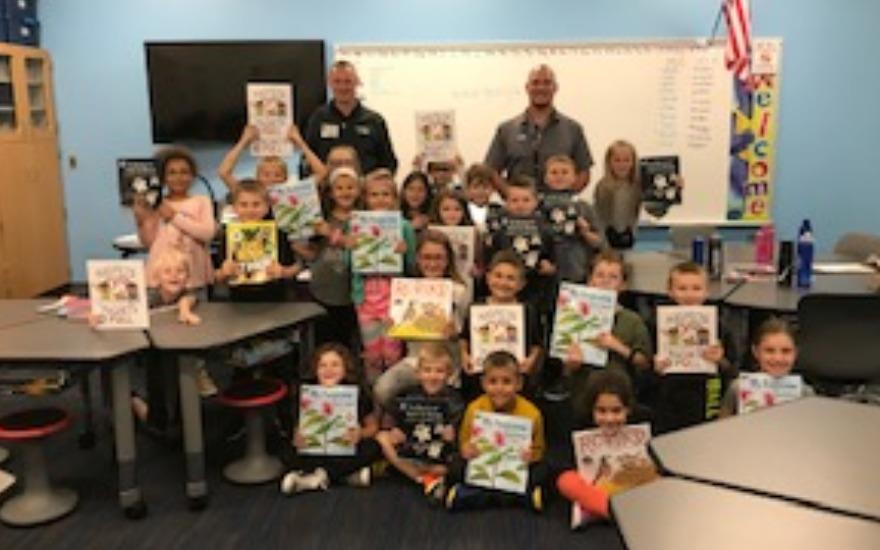 Serra Subaru Donates Book to Lake Intermediate