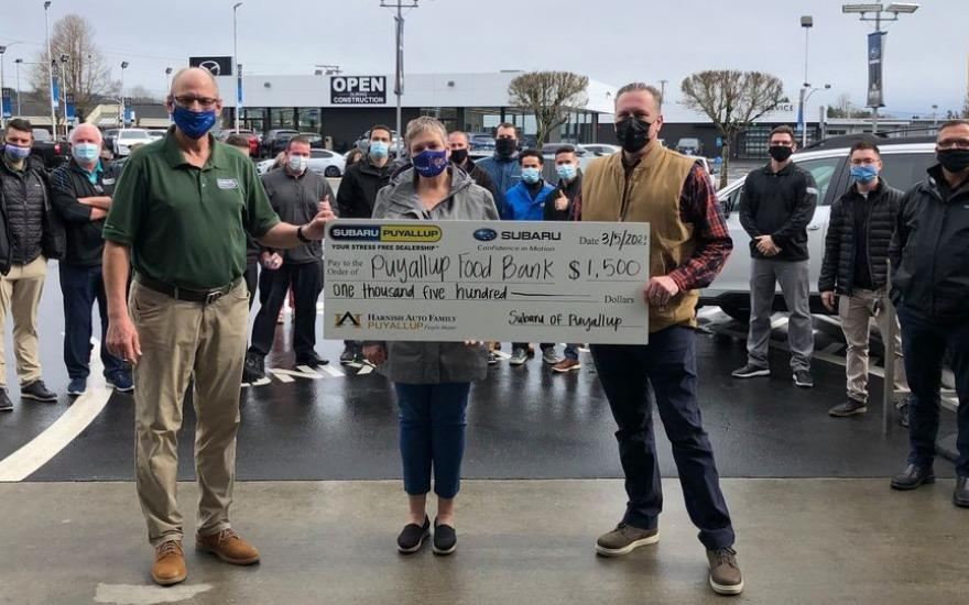 Subaru of Puyallup donates to Puyallup Food Bank