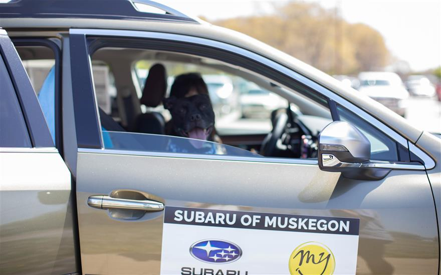 Subaru of Muskegon Moves First Dog to New Shelter